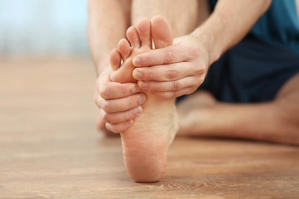 Man stretching his foot