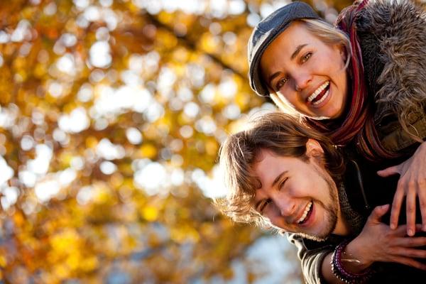 Loving couple smiling and enjoying the autumn season