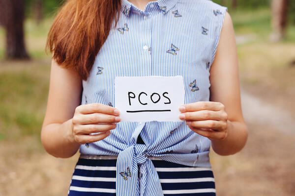Woman holding PCOS note