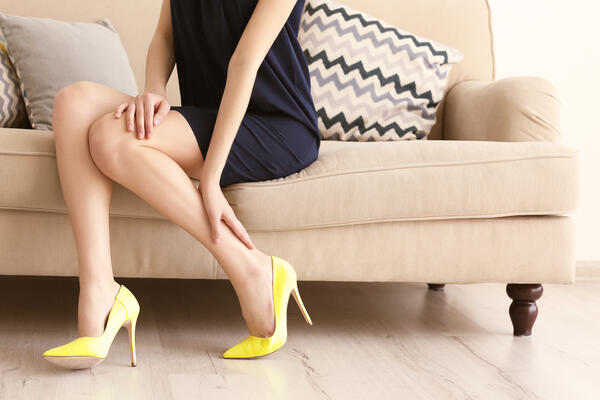 Woman in yellow high heels