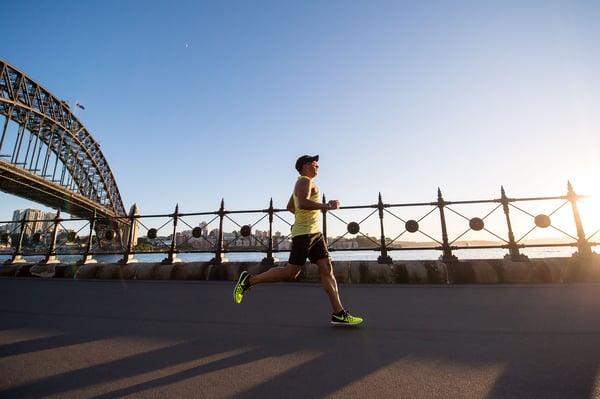 man running through city
